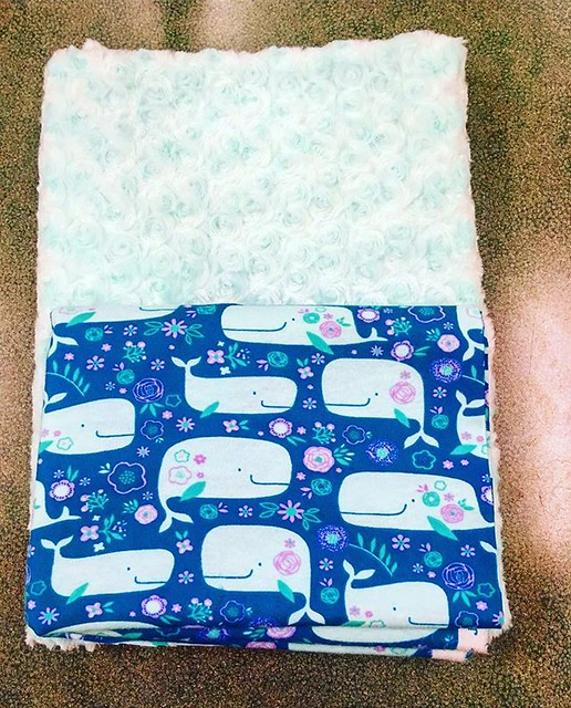 The faux fur was 40% off so I couldn't resist buying this aqua Minkie I'd been eying for months, with cute whale flannel to go on the other side. Does Goo need another baby blanket? No, but maybe I do. 🐳🐳🐳