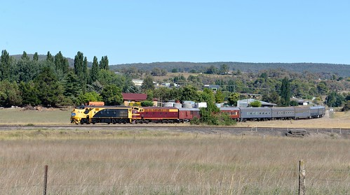With the former line to Dubbo in the foreground, 42103+4204 lead the Sydney bound 'Blue Suede Express' from Parkes cruise along through Molong, NSW. (3)
