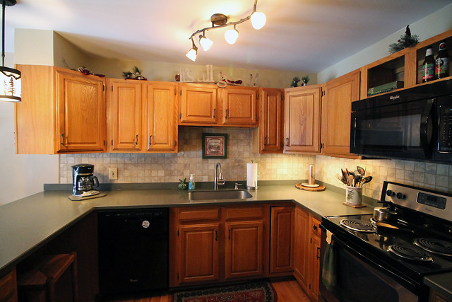 Updated kitchen with Corian counter tops, new light fixtures and appliances.