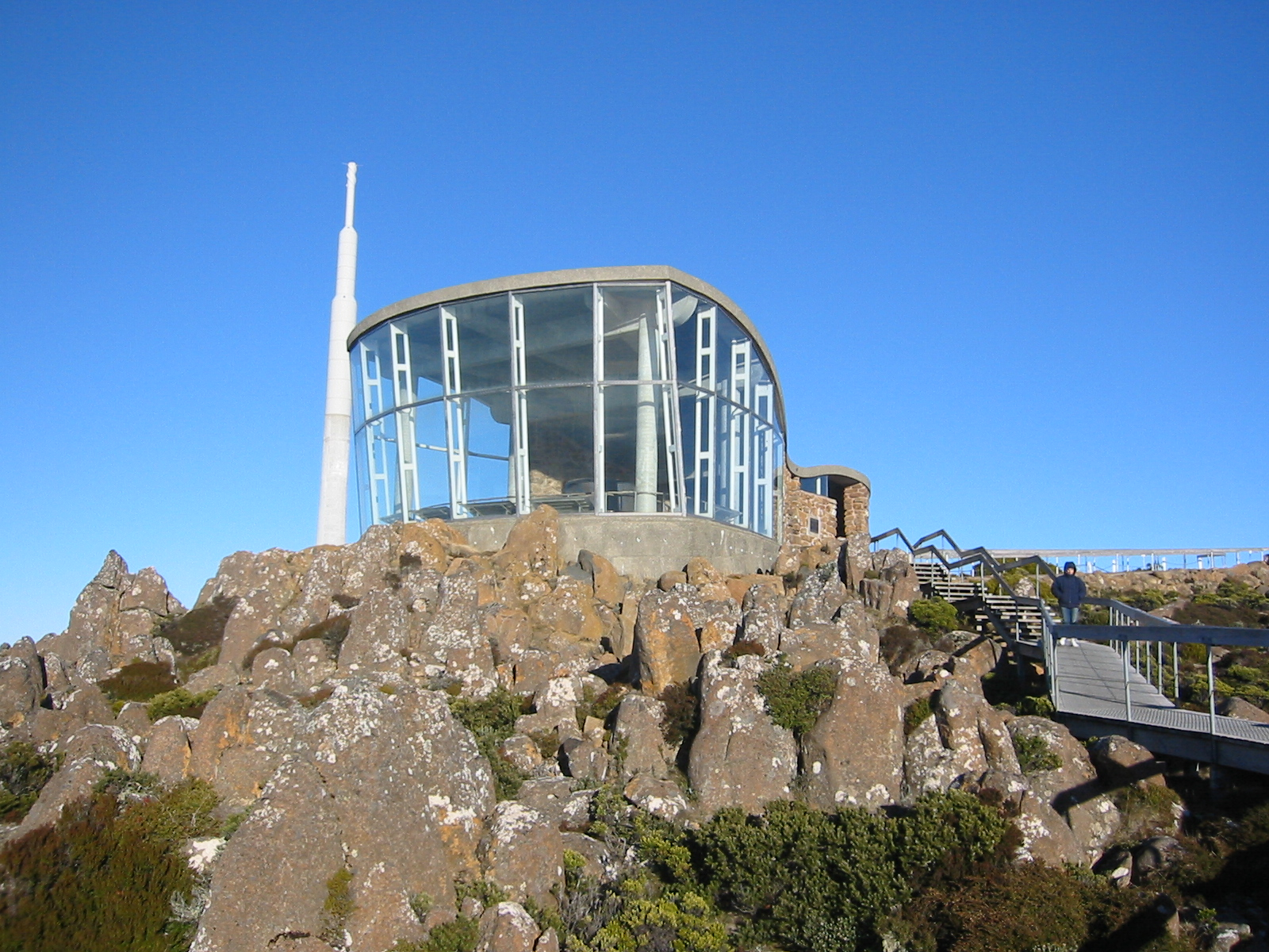 The lookout building near the summit, with the main television and radio transmitter in the background. Photo taken on June 29, 2005.
