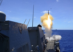 A Standard Missile (SM-2) is launched from the aft missile deck of USS Mustin (DDG 89) during the SAMEX, March 10. (U.S. Navy/MC2 William McCann)