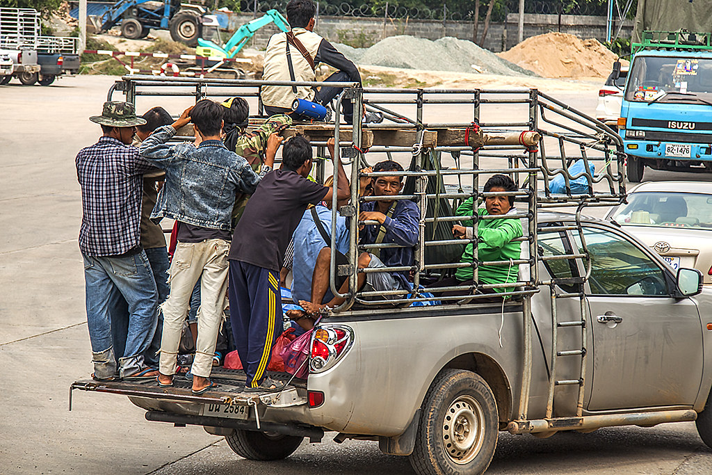 Cambodians on pickup truck--Thep Nimit