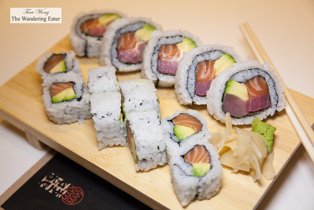 Two cut up rolls of salmon avocado and una, salmon and avocado