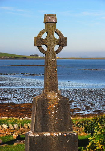 A Celtic cross at the edge of Clew Bay at the Murrisk Friary, Ireland