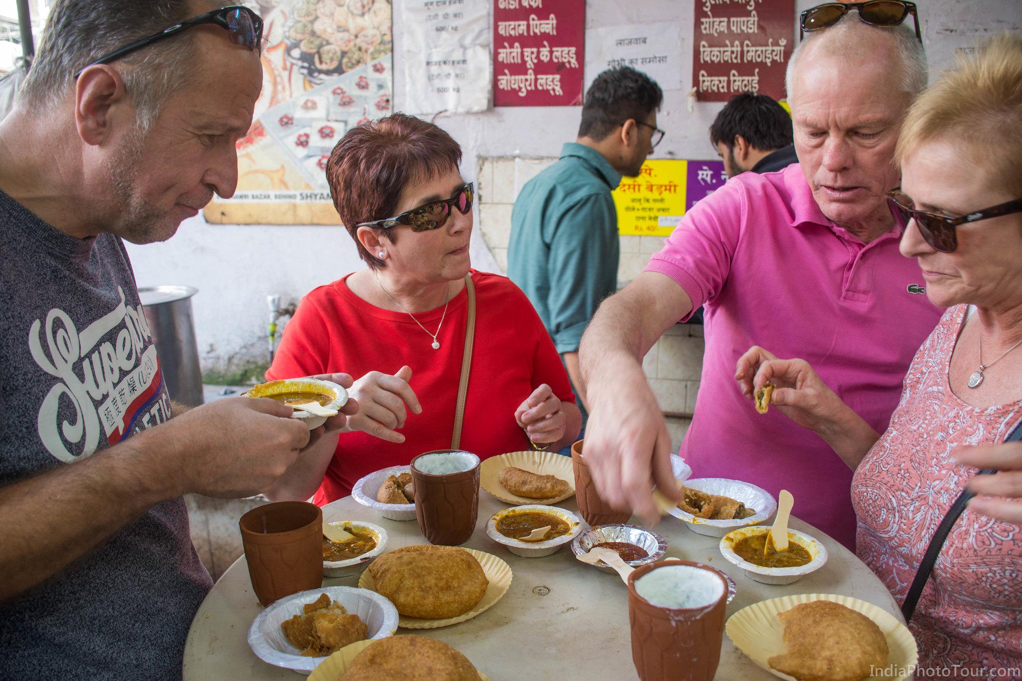 A meal of lassi, puri, kachori, samosa, aaloo sabzi to start the food tasting