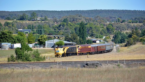 With the former line to Dubbo in the foreground, 42103+4204 lead the Sydney bound 'Blue Suede Express' from Parkes cruise along through Molong, NSW. (1)