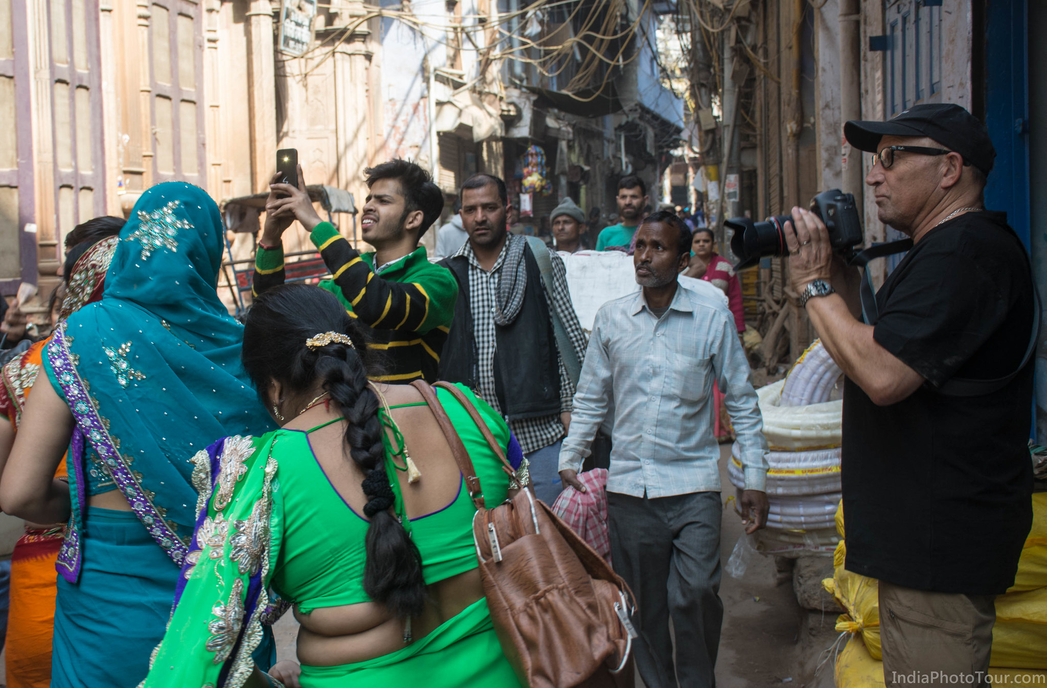 Photographing participants of the baaraat, some of whom were taking own pictures