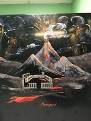 Vesuvius erupting, mural on toilet stall, men's room, Buca di Beppo restaurant, Washington, D.C.