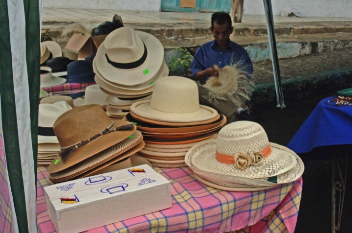 Hat stand in Montecristi, Ecuador. Streets in the central area of the town are lined with tables and shops offering these hats for sale. Photo taken on October 7, 2013.