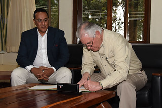 Secretary Tillerson Signs the Guestbook at the Kenya Wildlife Service in Nairobi