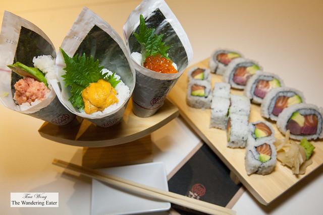 My trio of temaki hand rolls (tuna avocado, Maine sea urchin and ikura salmon roe) and two cut up rolls of salmon avocado and una, salmon and avocado