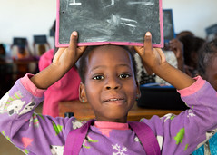 A student holds up her chalkboard in class