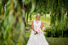 Stunning bride under willow tree