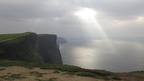 Rays poring out of the dark skies above the Cliffs of Moher, Ireland