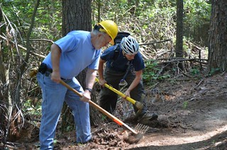 Volunteers Bob Crowl of the Chattahoochee Trail Horse Association (CTHA) and David Muse of the Southern Off-Road Bicycle Association (SORBA) work side-by-side to deberm a trail in the Jake and Bull Mountain trail system on National Trails Day, June 2, 201