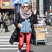 A woman crossing 47th Street along 8th Avenue. by kevinrubin