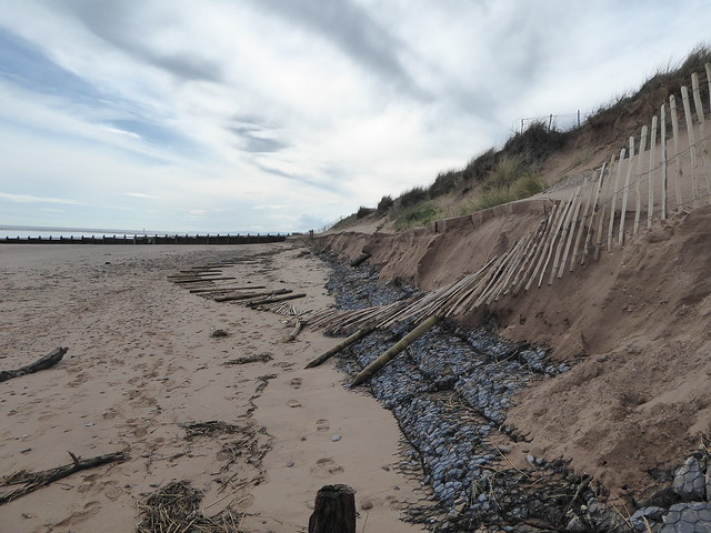 Damaged sand cliffs at Dawlish Warren