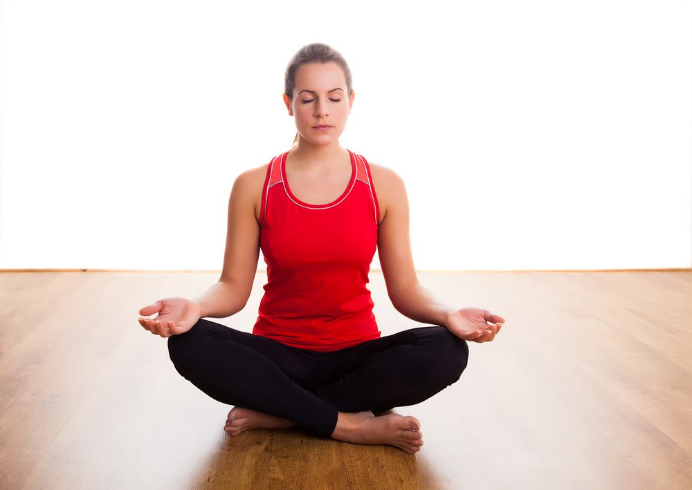 seated woman doing breathing exercise
