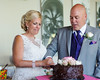 Bride and Groom cutting into the cake