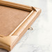 Wooden photo frame on marble background. Close up.jpg