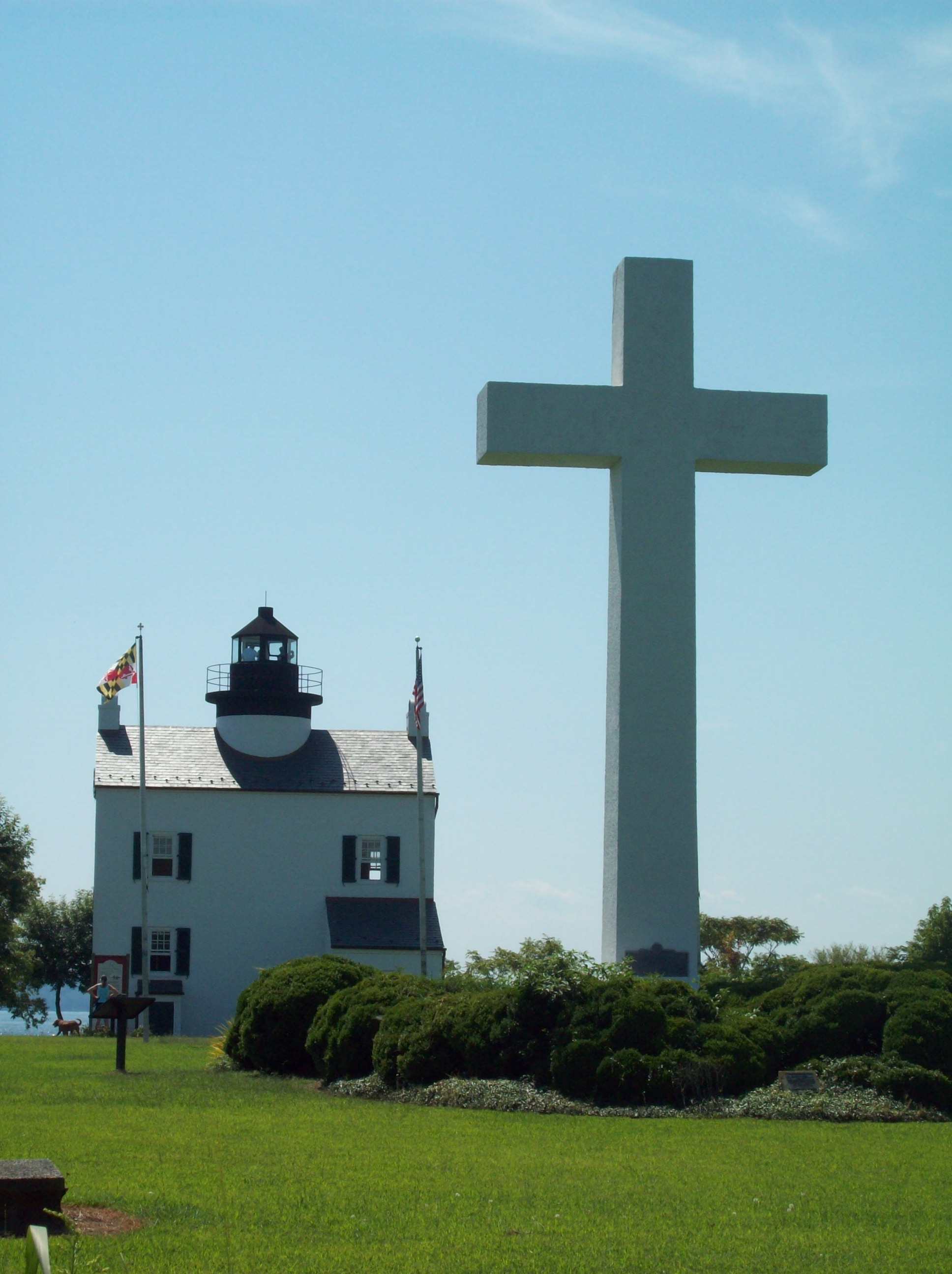 Commemorative cross and rebuilt Blackistone Lighthouse on St. Clement's Island, Maryland. Photo taken on September 5, 2009.