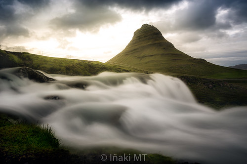 grass river bright natural sunrise sunset iceland volcanic landmark stream kirkjufellsfoss beauty panorama volcano picturesque water island sun nature cascade waterfall beautiful travel icelandic hill kirkjufell sky green outdoor europe landscape mountain occidental islandia is