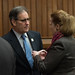 Rep. John Fusco speaks with Rep.Kathleen  McCarty during a recent session day at the state capitol.