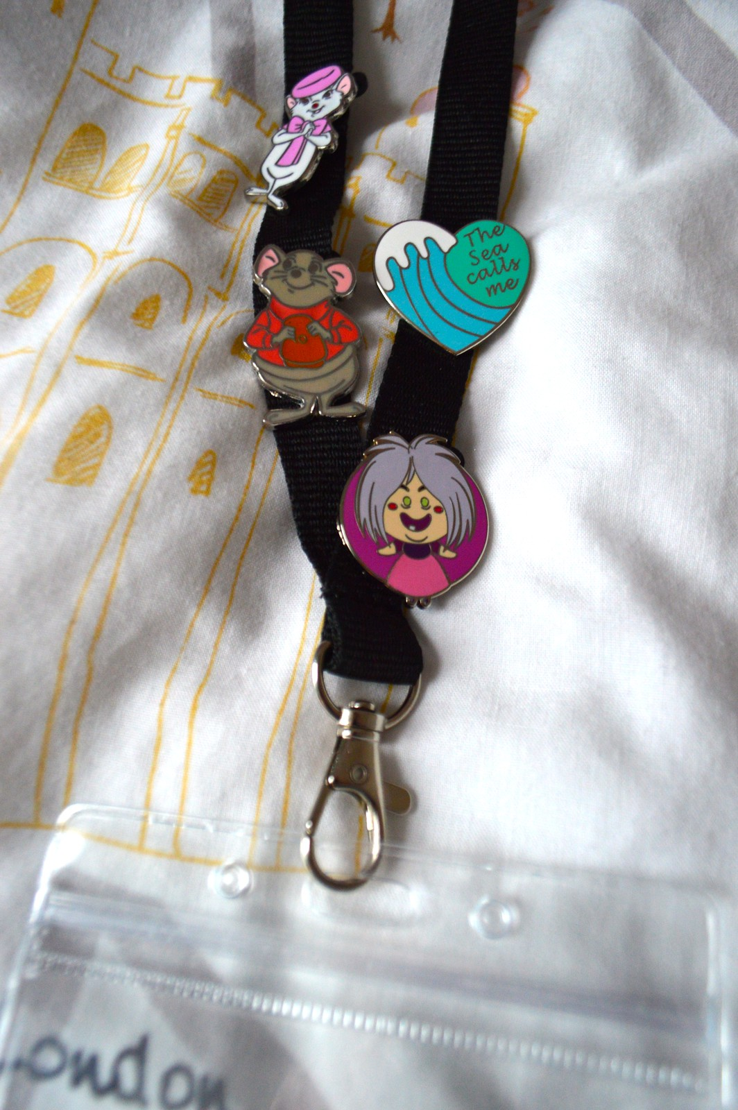 This is a picture of a lanyard with disney pins attached