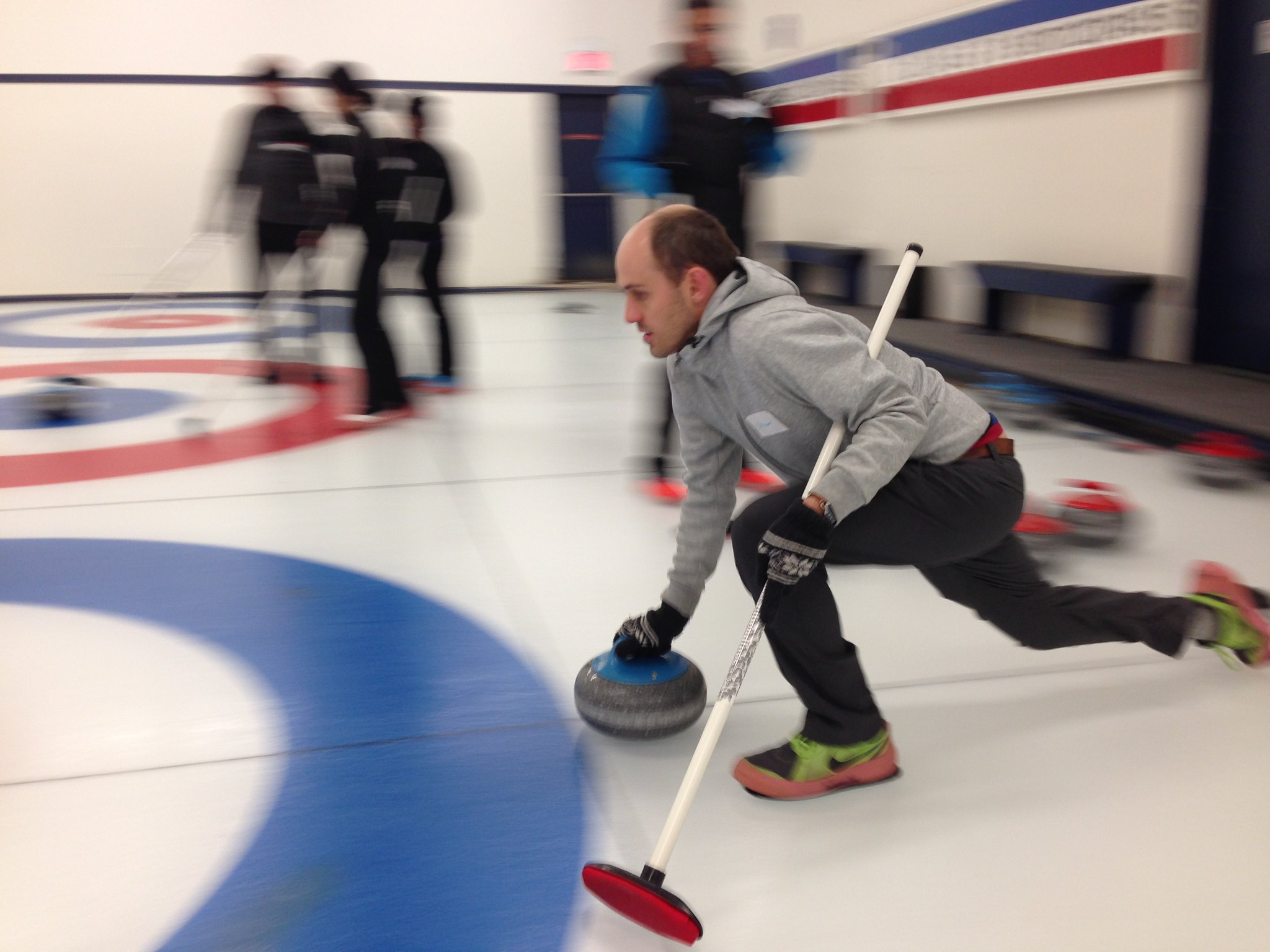 Playing a game of curling for the first time.