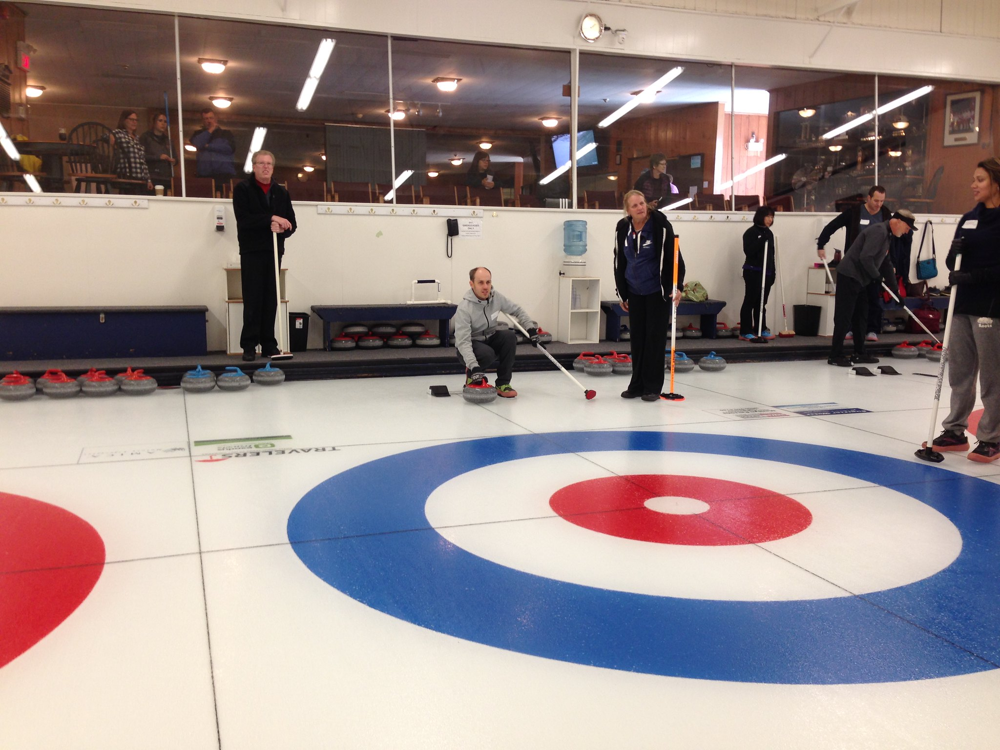 Getting ready to deliver the curling stone.