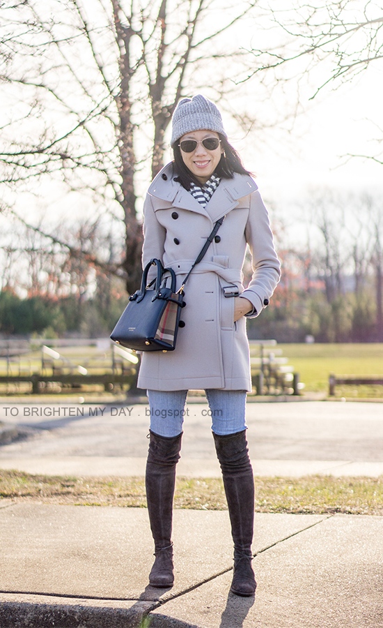 gray beanie, gray wool coat, striped scarf, navy crossbody tote, lightwash skinny jeans, gray suede over the knee flat boots