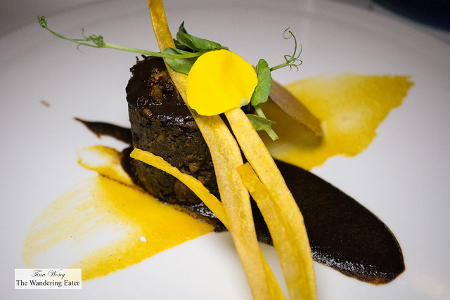 Duck in mole negro, fried banana plume served with corn flavored rice