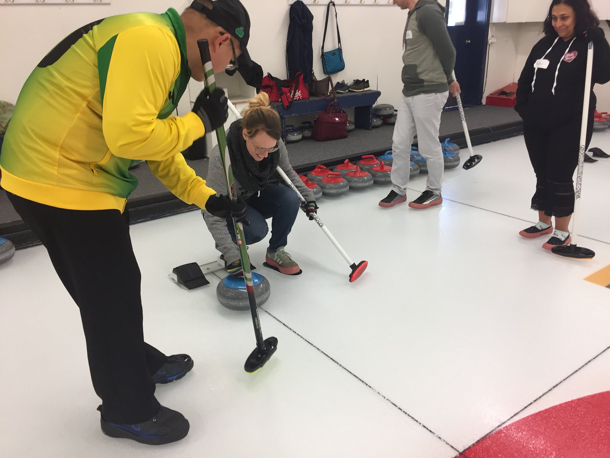 Being taught how to deliver the stone in curling