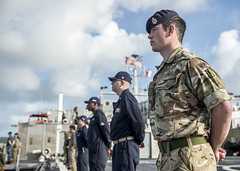 Mutinational service members aboard USNS Brunswick (T-EPF 6) man the rails as the ship arrives in Colonia, March 20. (U.S Navy/MCSN Caledon Rabbipal)