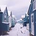 mudeford beach huts in the snow