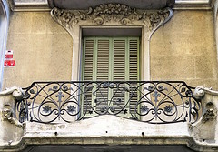 Floral window frame and wrought iron balcony, Barcelona