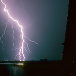 16. Juuli 2003 - 0:00 - After an extremely hot day (temperatures up to 35C) in the never ending summer of 2003, I chased night time storms in the province of Flevoland. A line of storms produced a lightning barrage near the city of Lelystad, with many, many branched CG's (Cloud-Ground discharges). Fortunately now and then we could take shelter below the bridge to the right, because it wasn't entirely safe in the wide open....  I used Kodachrome-64 slide film with an aperature of f/8 with an exposure of 15 seconds.