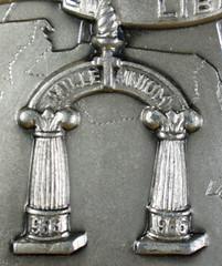 Polish medal MILLENIUM atop columns