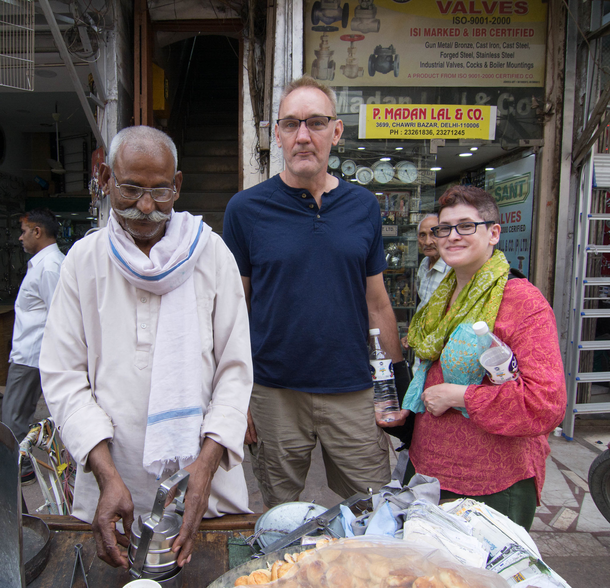 Posing for a photograph with a local cookie seller