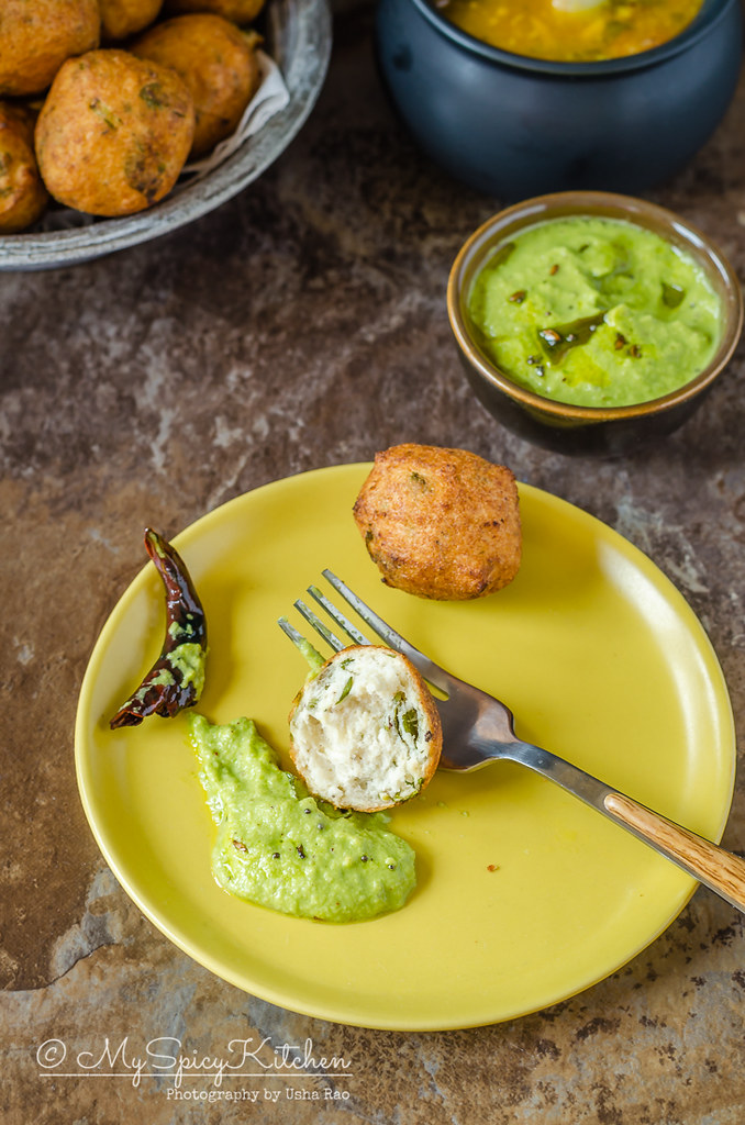 A plate of black gram lentil balls with coconut chutney.  Mysore bonda is a crispy deep fried snack made with urad dal.