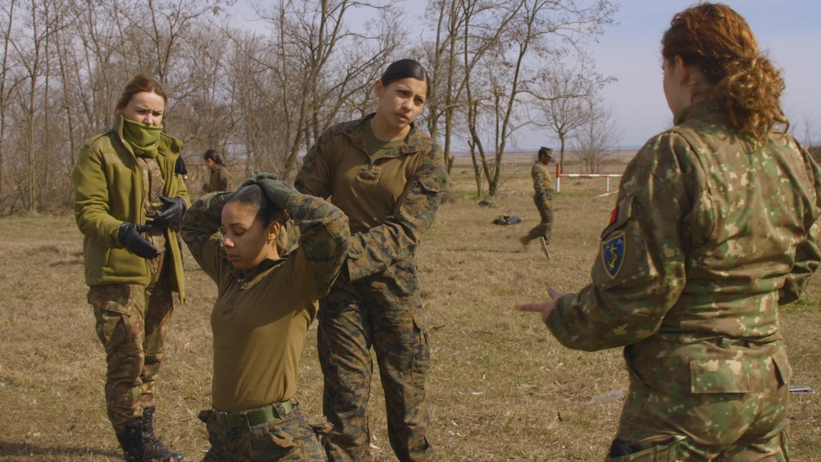 CAPU MIDIA TRAINING AREA, Romania (March 9, 2018) A U.S. Marine assigned to the Female Engagement Team (FET), 26th Marine Expeditionary Unit (MEU), and the Romanian FET conduct detainee handling during bi-lateral training at Capu Midia Training Area, Roma