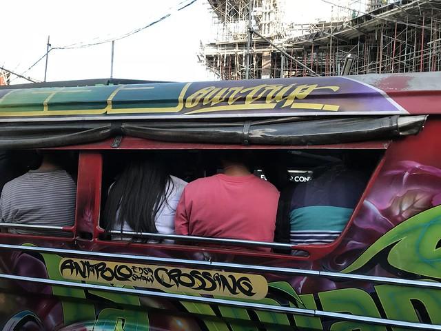 jeepney passengers,  long hair