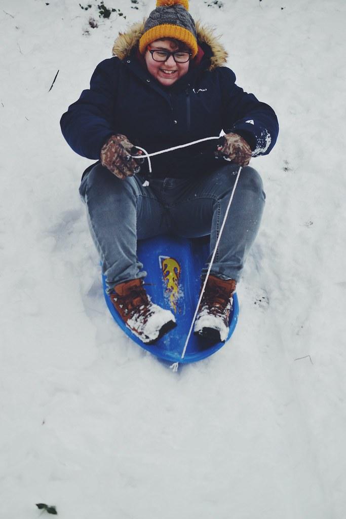 Mama sledding snow day