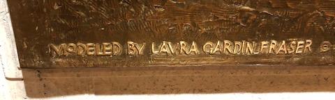 Laura Gardin Fraser signature on The Long Long Trail Roosevelt plaque closeup