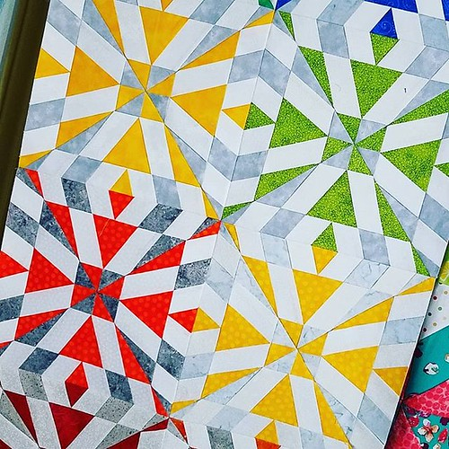 More #secondarypattern from #rainbowcascadeqal! Even though I still have more blocks to make, I couldn't resist piecing together a couple of columns! #sewhookedpattern free on sewhooked.com. #paperpieced