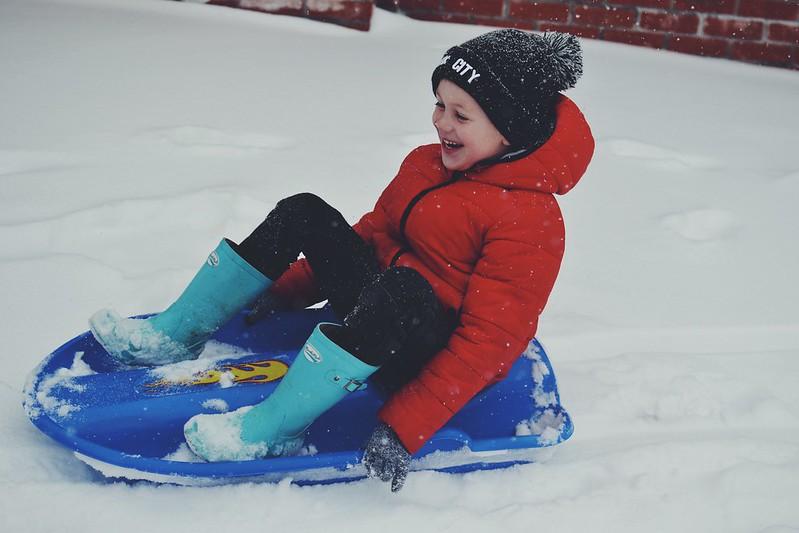Big sledding smiles Snow Day