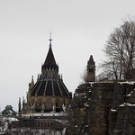 A view of A view of Canada`s Library of Parliament captured along the shores of the Ottawa River in Ottawa, Ontario