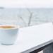 Coffee break at a beach bar. Sea background. by wuestenigel
