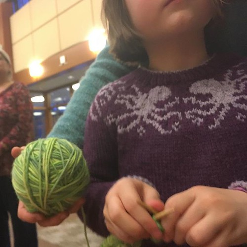 She didn't even want to stop knitting while we waited in line for Show&Tell, so I held her yarn for her!