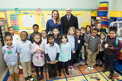 Rep. Cummings posed for a group photo with principal Mathew Calabrese after reading to Mrs.Maureen Keeley's first grade class at Chase School.